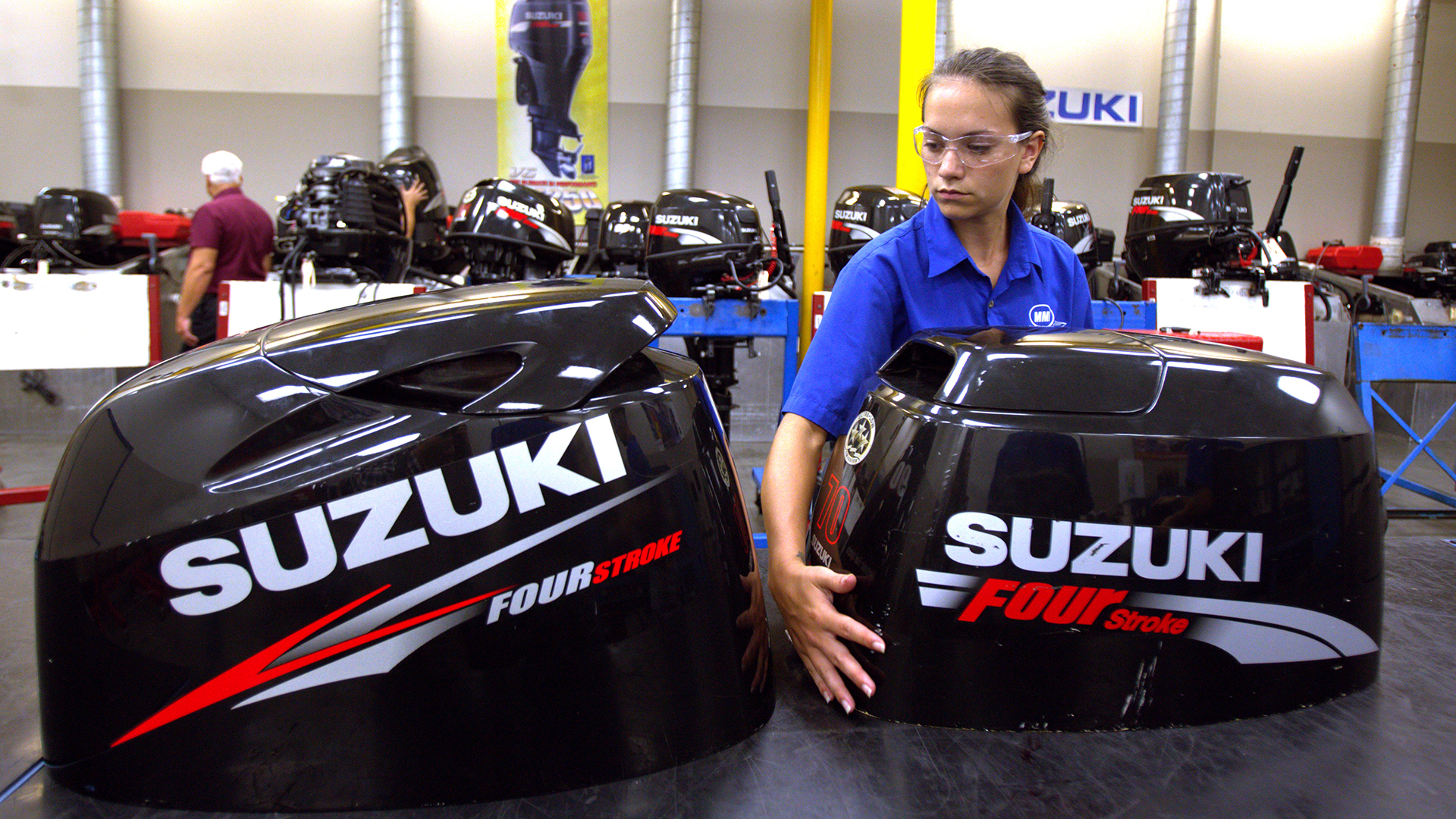 MMI student moving Suzuki parts in the Suzuki marine lab
