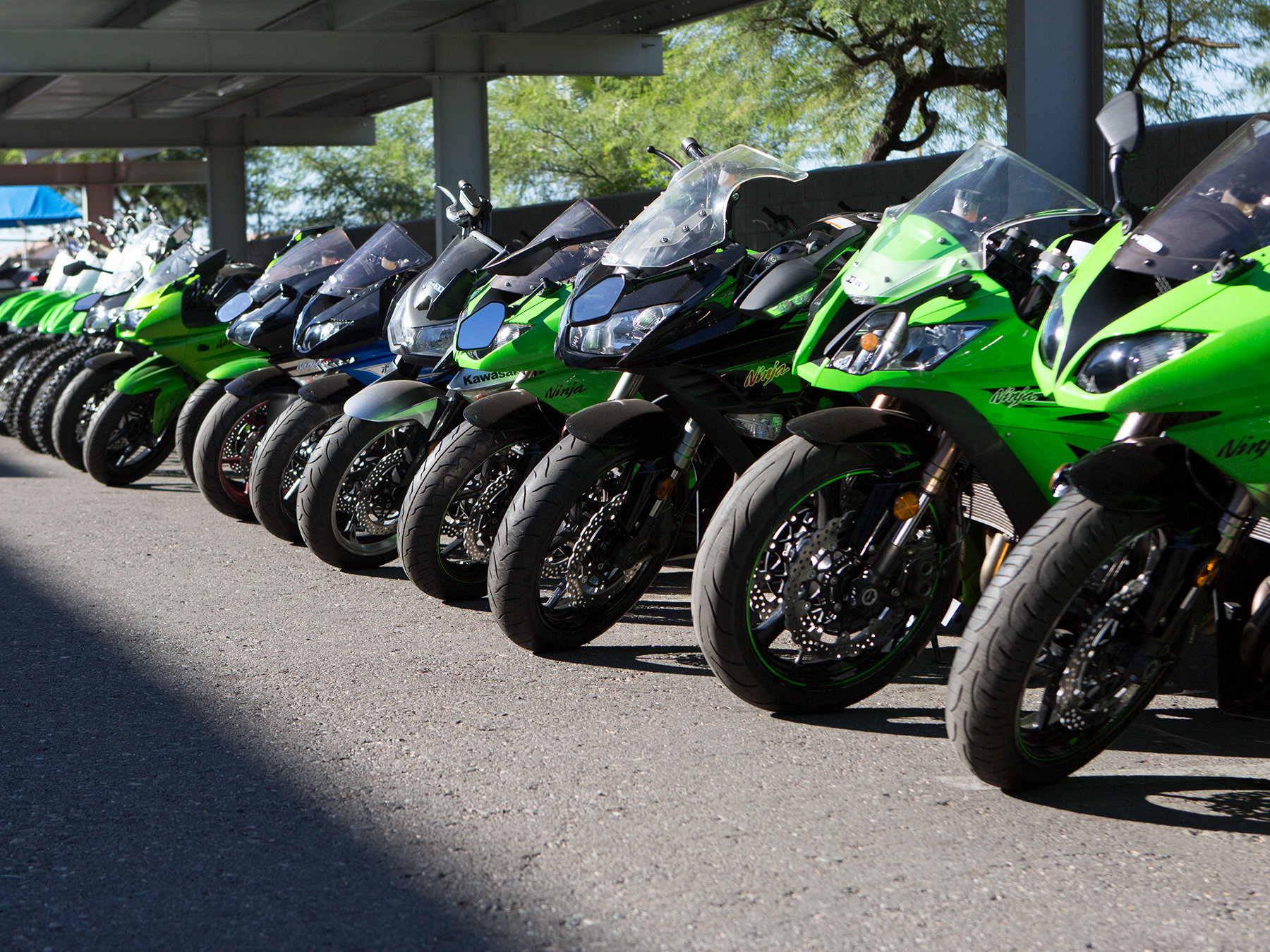 Green Kawasaki Motorcycles outside