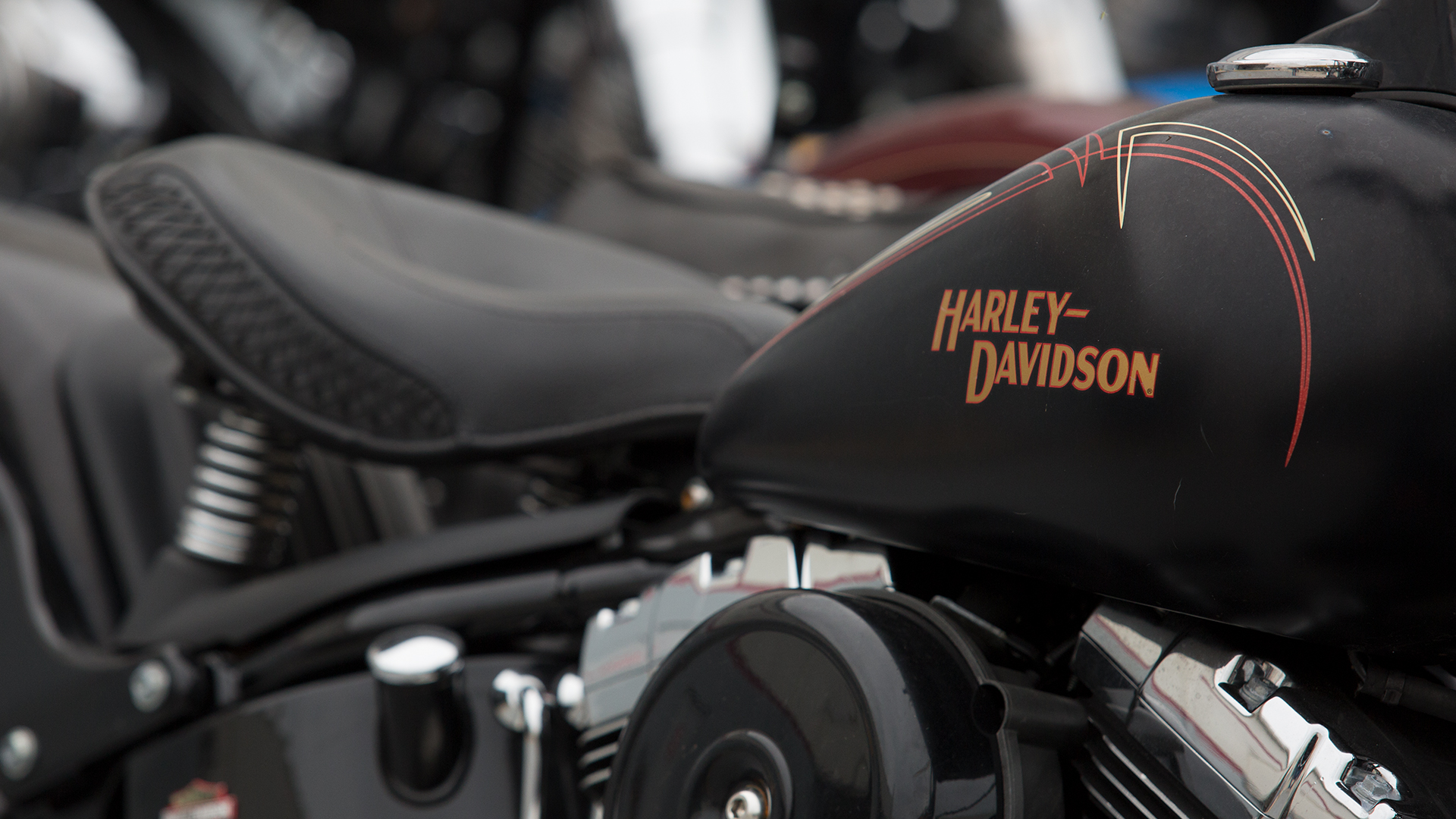 Black and orange Harley Davidson motorcycle