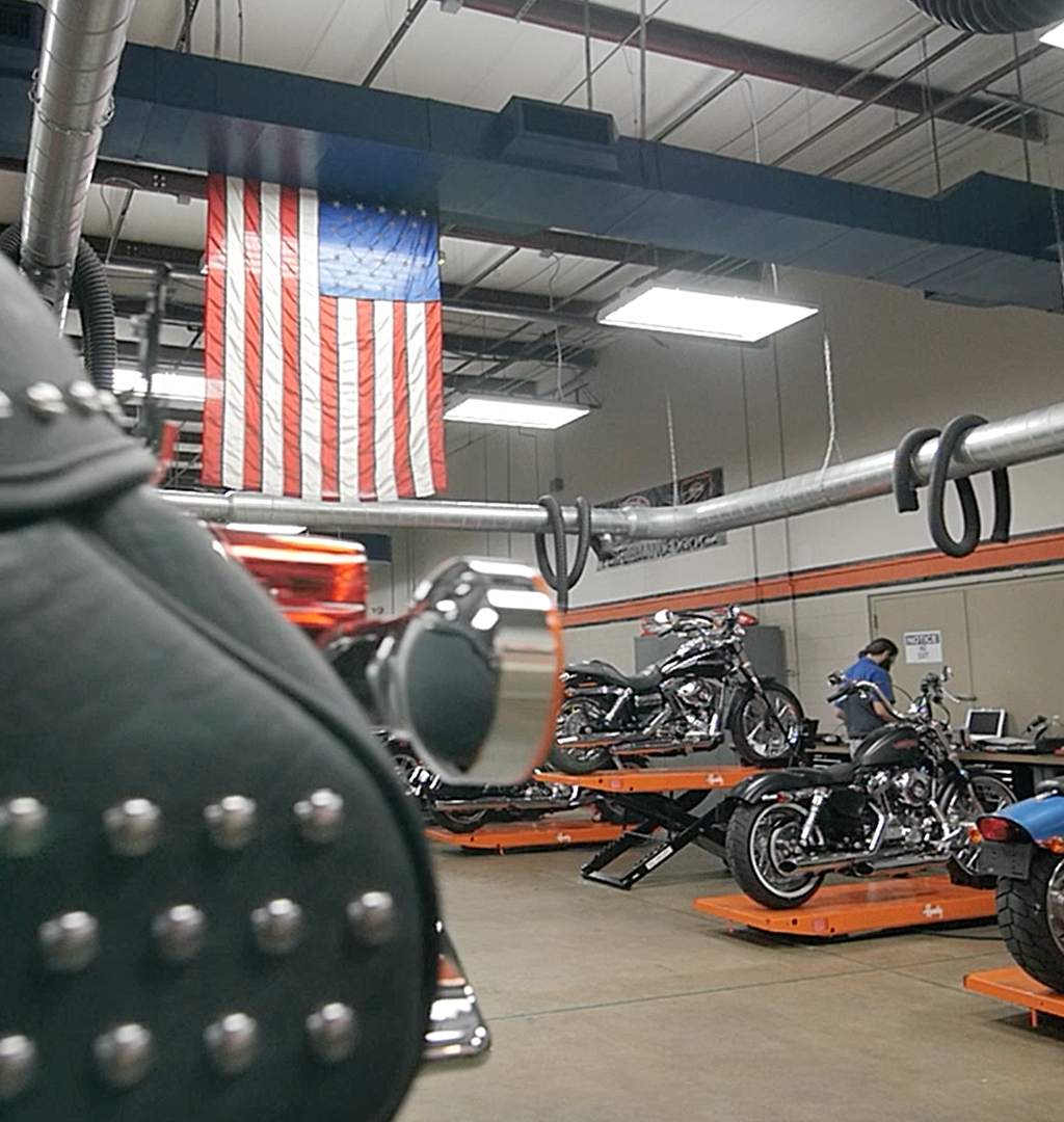 Wide angle photo of the Harley Davidson lab with the American flag hanging from the ceiling
