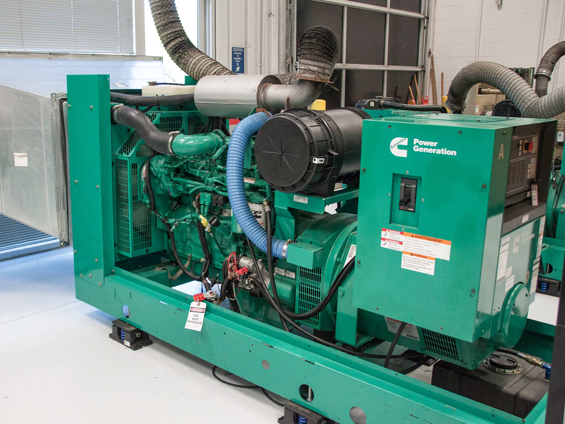 Angled photo of a Green cummins power generator in the cummins lab