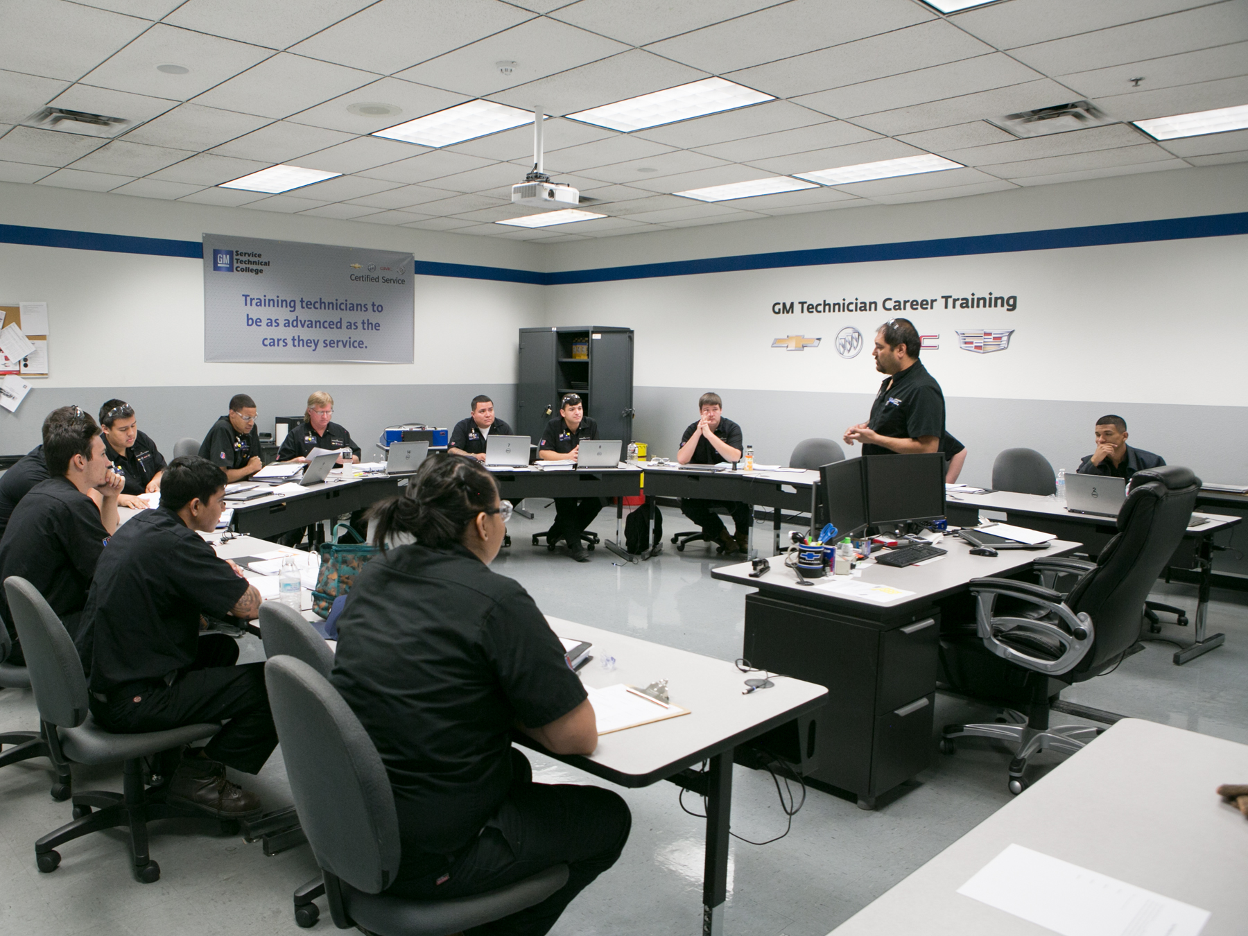 UTI students and Instructor in the GM classroom learning