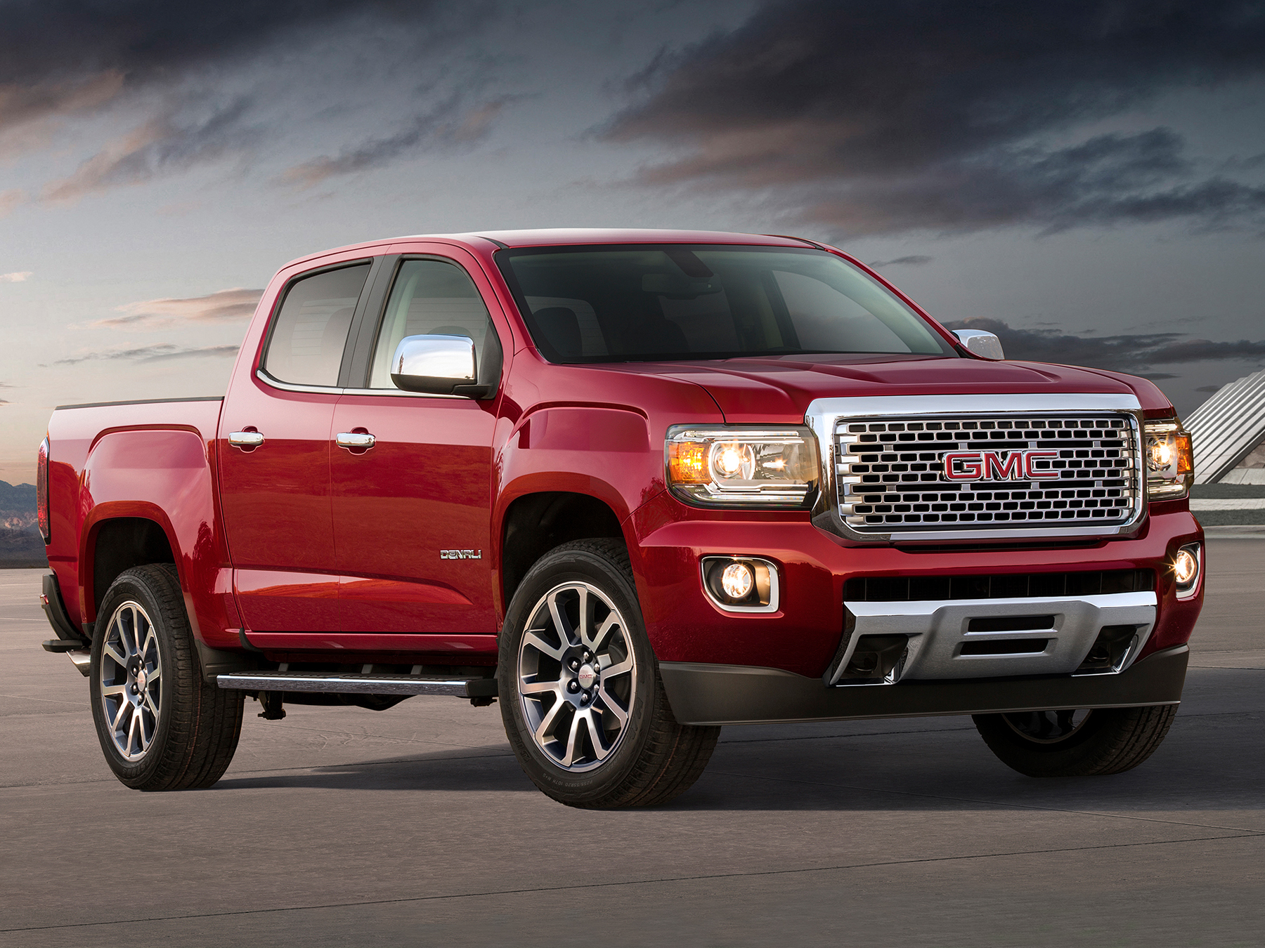 Red GMC Denali truck