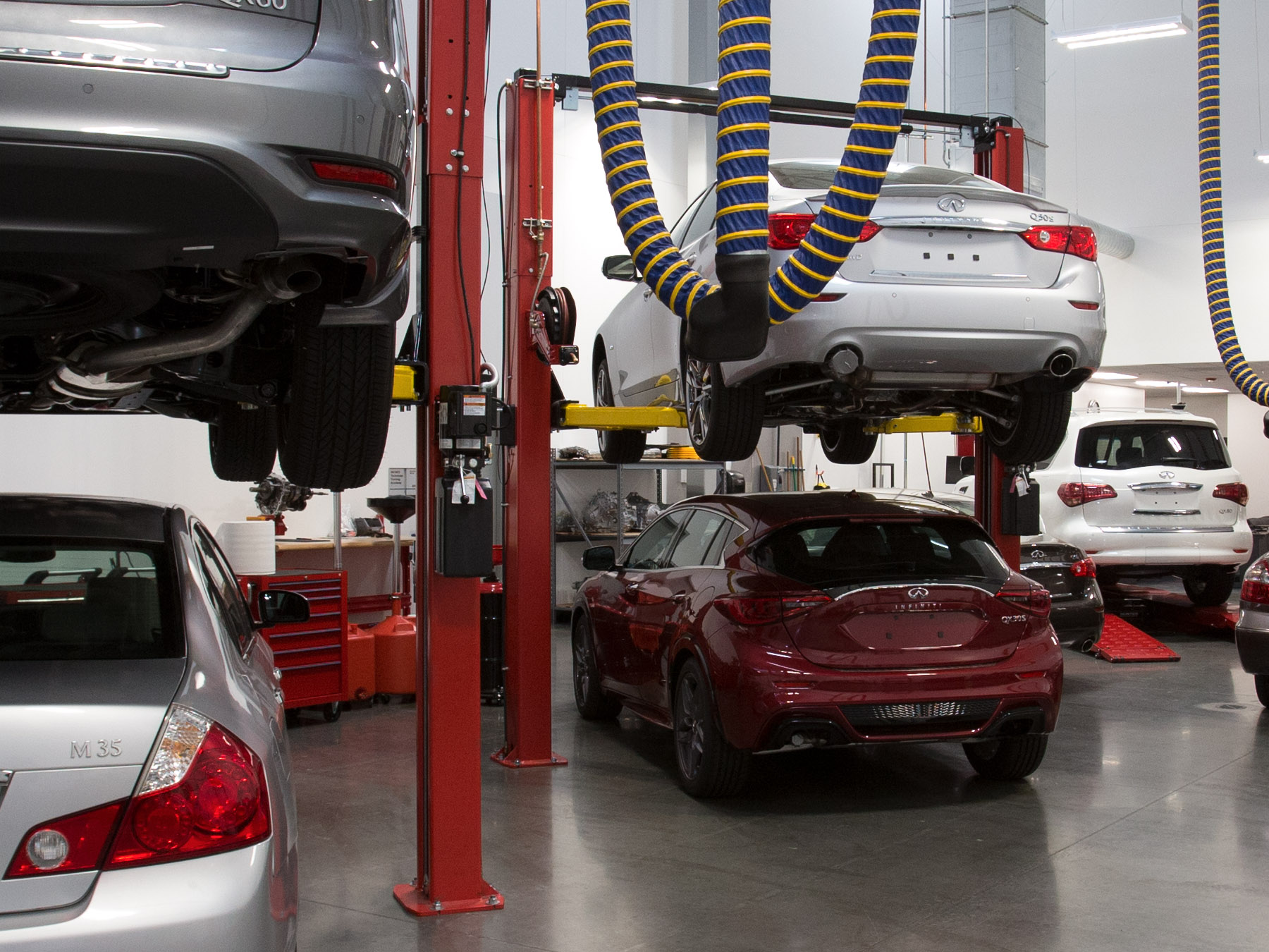 Infiniti Cars on lifts in the Infiniti auto lab