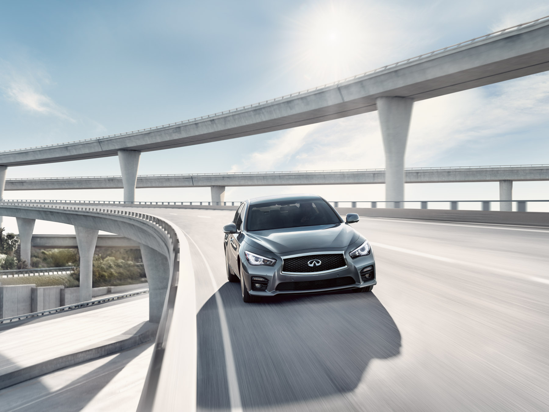 Grey Infiniti Q50 driving on the highway