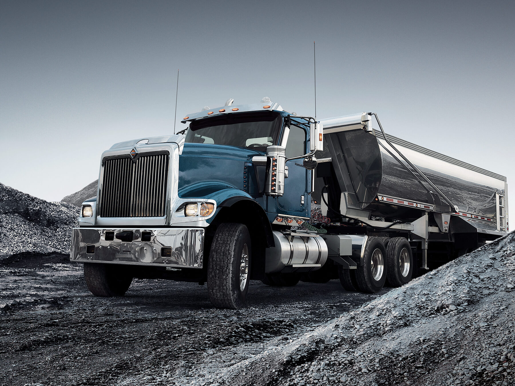 Blue international diesel truck in the grey dirt