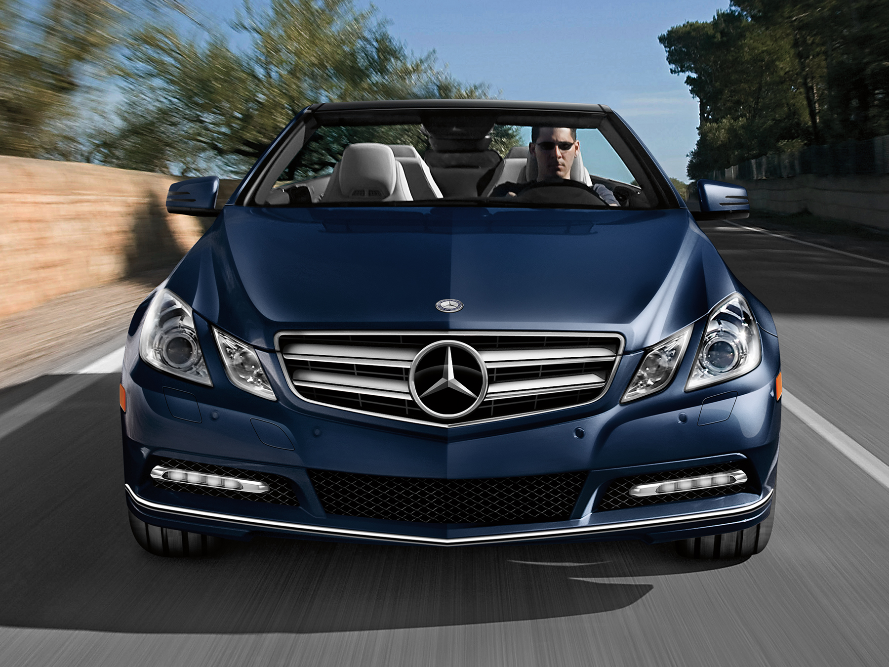 Blue Mercedes-benz E350 driving