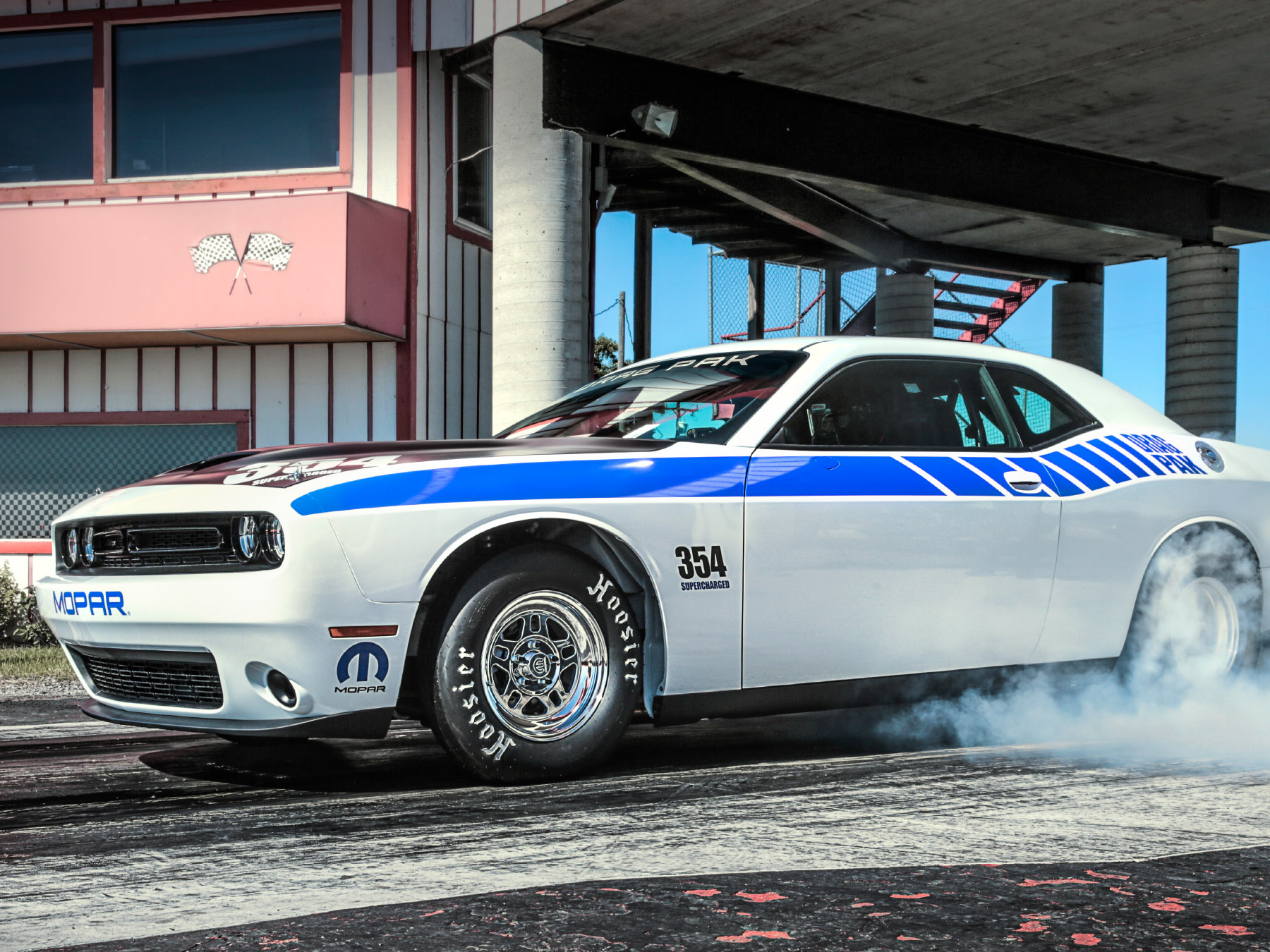 White and Blue mopar Dodge Challenger doing a burnout