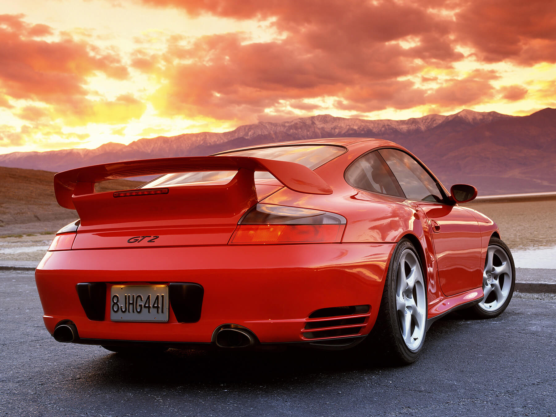 Red Porsche GT2 in the sunset