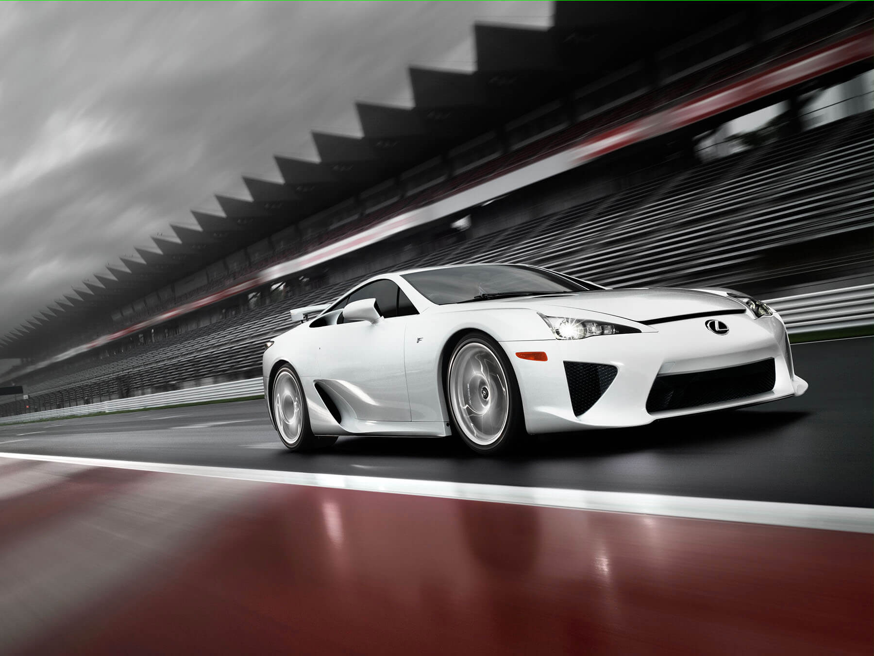 White Lexus LFA driving on a track