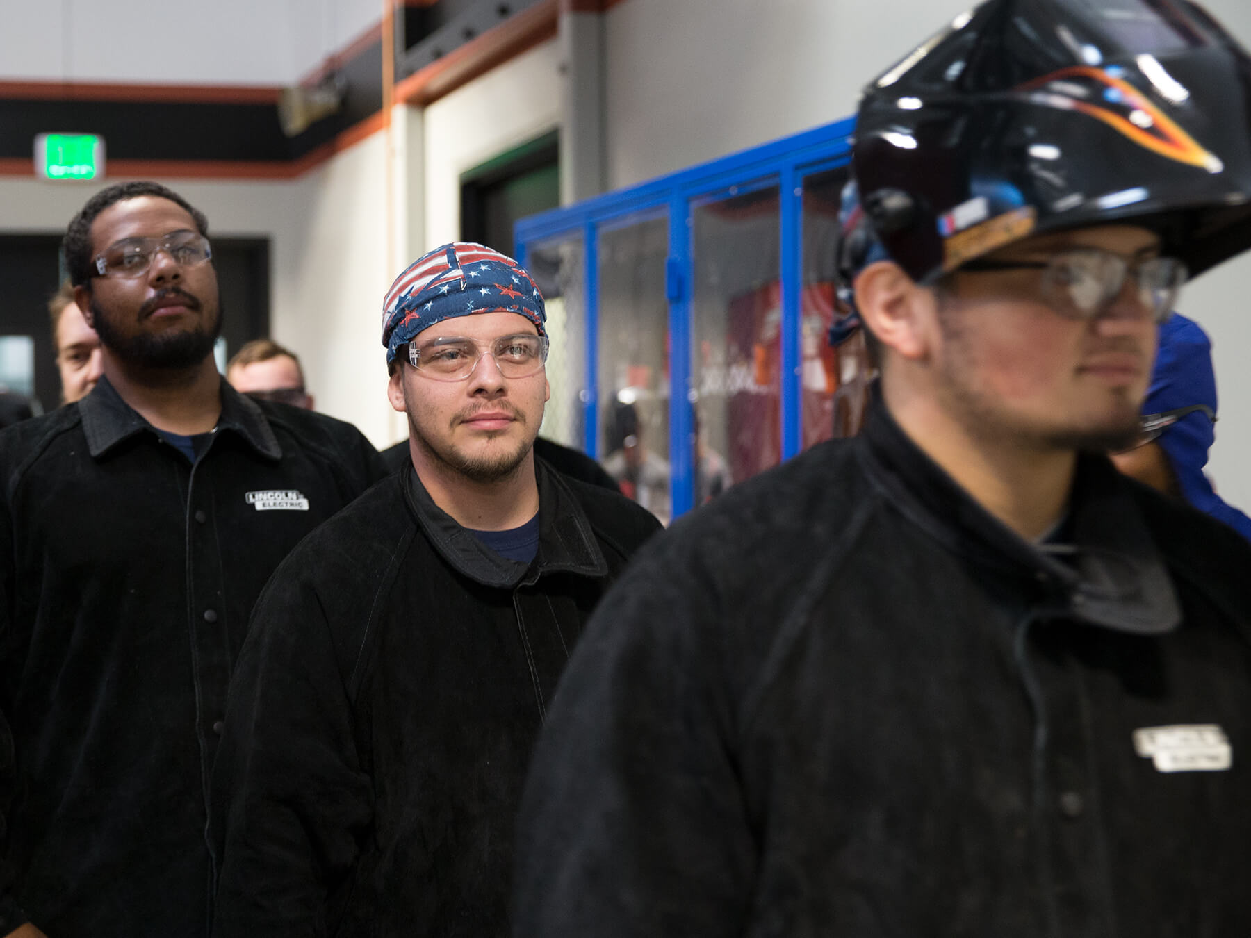 Photo of welding students walking