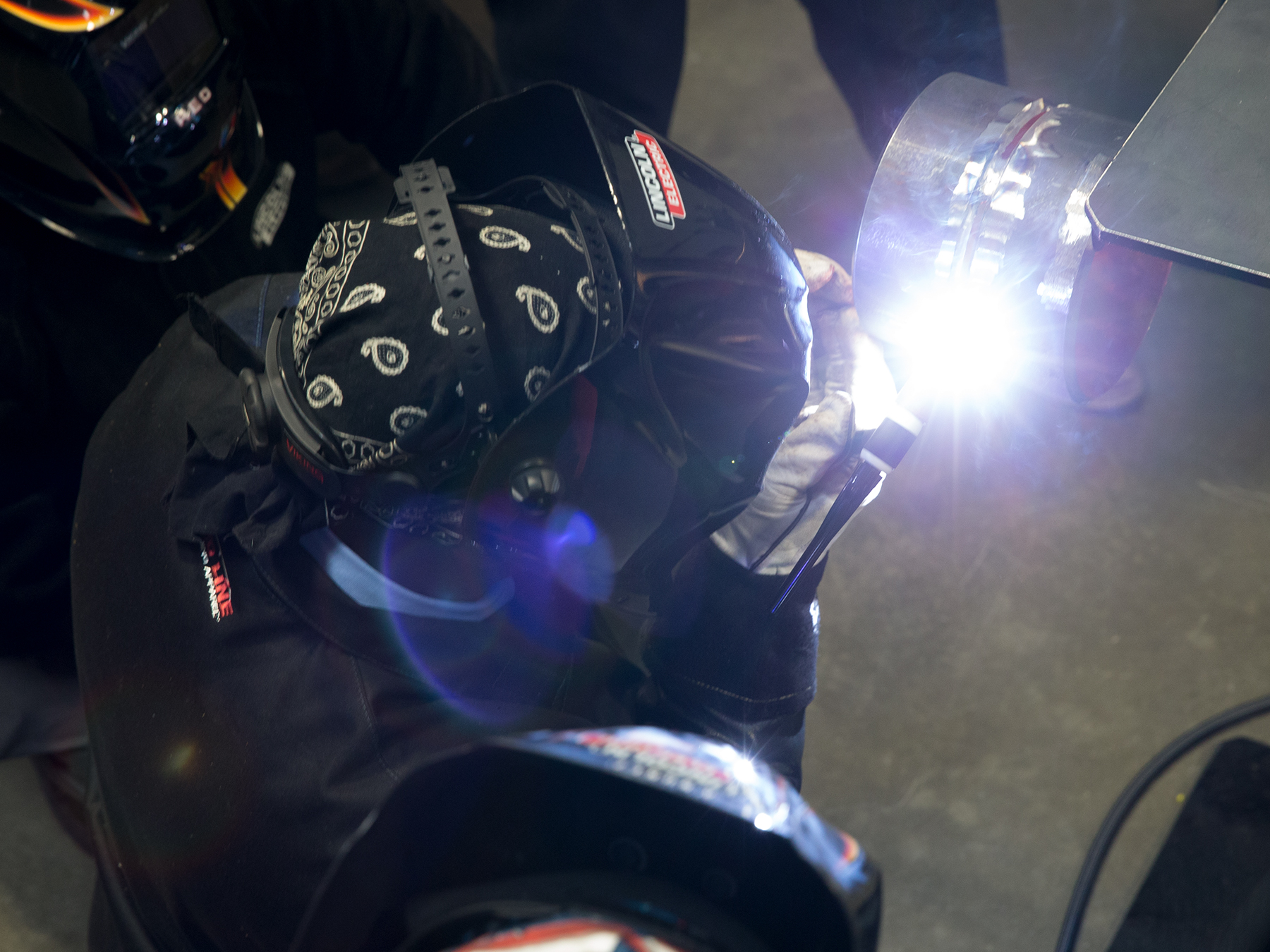Overhead photo of a welding instructor welding creating a bright light