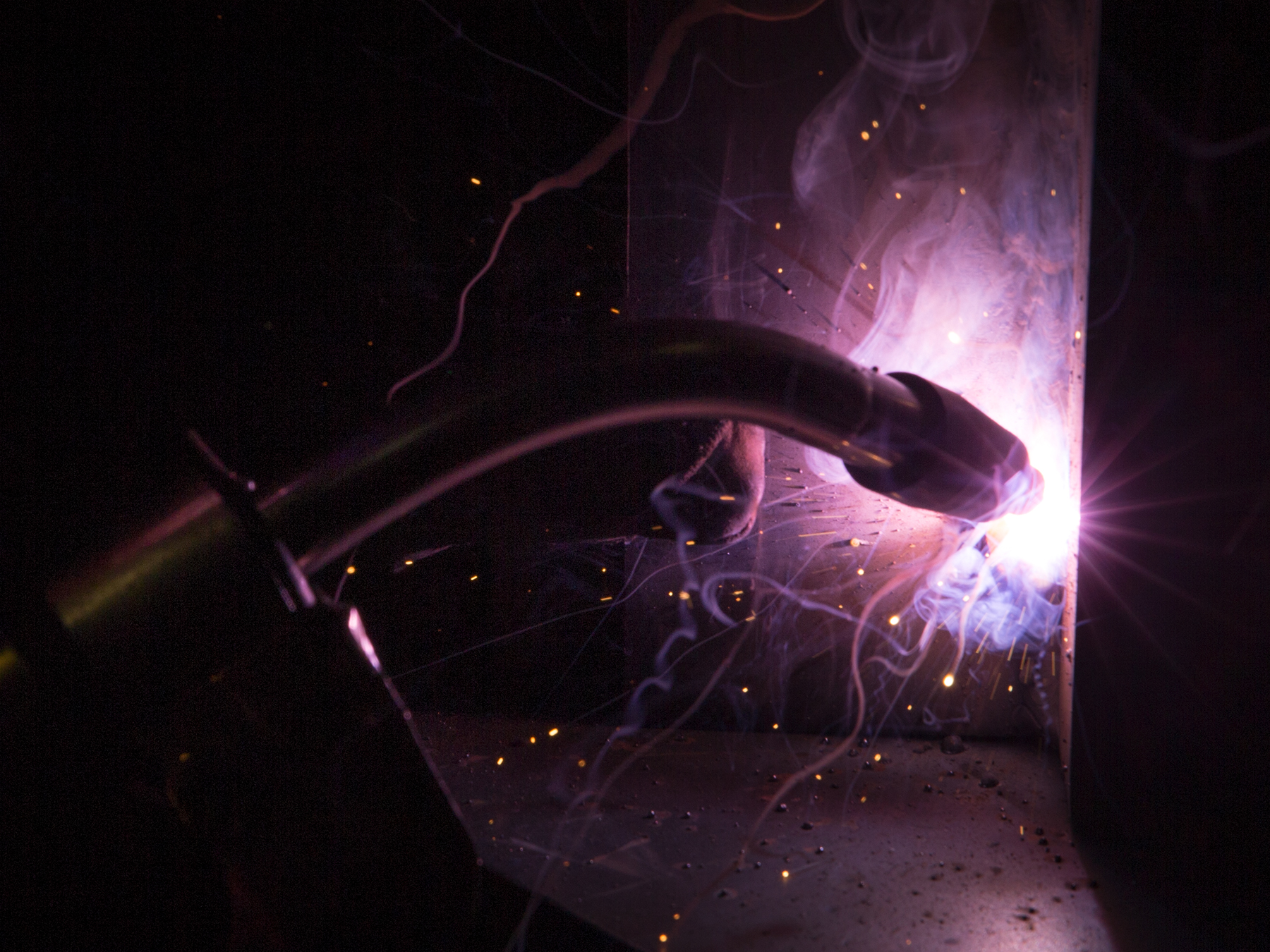 Close up photo on the welding flame creating a purple light