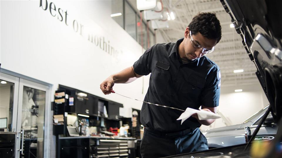 UTI student working on a car